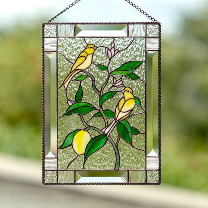 Stained glass canary birds sitting on the lemon tree panel