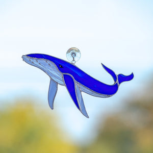 Royal blue stained glass whale with sky-blue lower part suncatcher for window