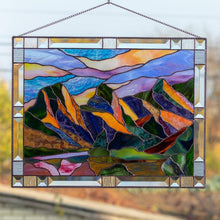 Load image into Gallery viewer, Stained glass panel depicting Three Sisters Mountains with sky of different shades