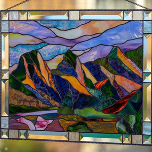 Zoomed stained glass Three Sisters Mountains window hanging