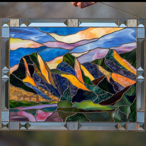 Three Sisters Mountains panel of stained glass