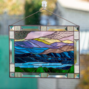 Panel of stained glass depicting mount Washington