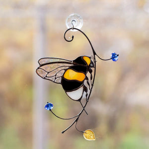 Clear-winged bumblebee sitting on the branch suncatcher