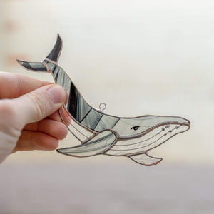 Black and grey stained glass whale with clear lower part suncatcher for window