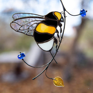 Stained glass sitting on the branch bumblebee window hanging