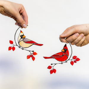 Stained glass suncatcher of male and female cardinals