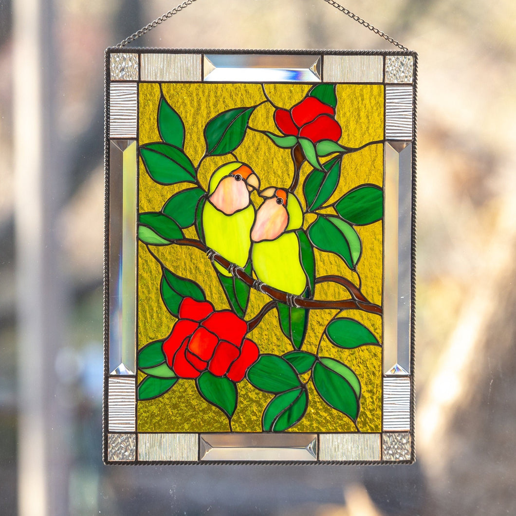 Stained glass panel depicting lovebirds sitting on the branch with flowers