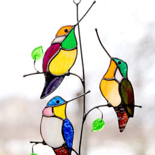 Load image into Gallery viewer, Zoomed stained glass hummingbirds sitting on the vertical branch suncatcher