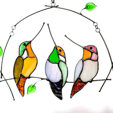 Load image into Gallery viewer, Three zoomed stained glass hummingbirds sitting on the horizontal branch suncatcher