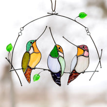 Load image into Gallery viewer, Sitting on the horizontal branch with leaves stained glass hummingbirds window hanging