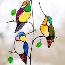 Load image into Gallery viewer, Three zoomed stained glass hummingbirds on the branch with leaves suncatcher