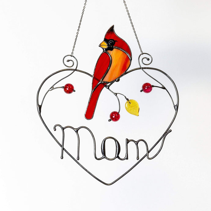 Stained glass suncatcher of a cardinal sitting on a wire heart with personalization