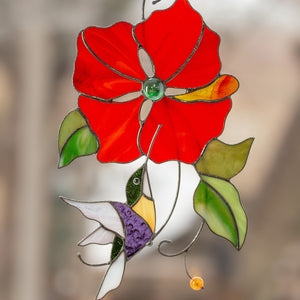 Flying towards the red flower stained glass hummingbird window hanging