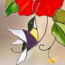 Load image into Gallery viewer, Zoomed hummingbird flying to the red flower stained glass suncatcher