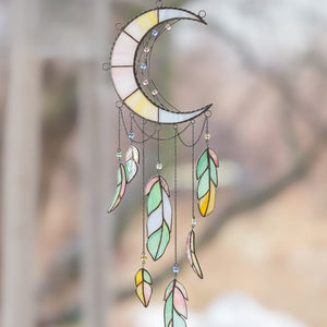 Stained glass moon-shaped dreamcatcher with colourful feathers