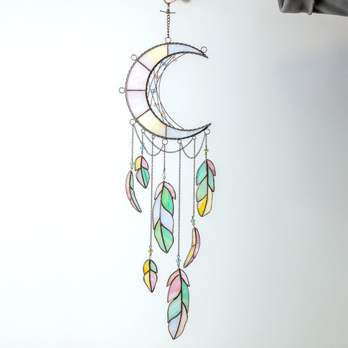 Stained glass moon dreamcatcher with colourful feathers in the lower part