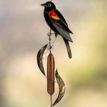 Load image into Gallery viewer, Stained glass red-winged blackbird sitting on the reeds window hanging