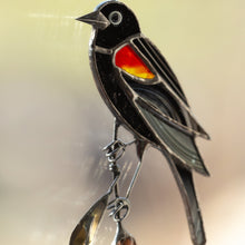 Load image into Gallery viewer, Red-winged zoomed stained glass blackbird sitting on the reeds suncatcher