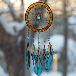 Flower-shaped stained glass dreamcatcher with hanging down blue feathers