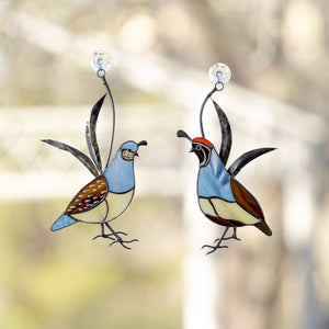 A pair of stained glass male and female California quails suncatchers