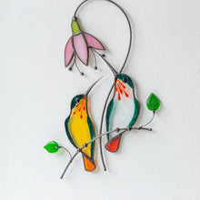 Load image into Gallery viewer, Green hummingbirds on the branch with pink flower suncatcher of stained glass