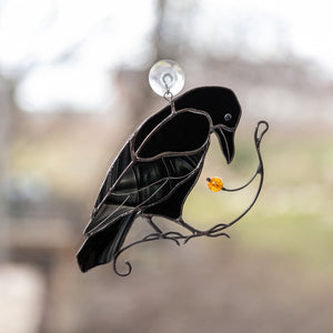 Stained glass raven on the branch suncatcher for window decoration