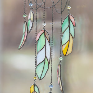 Zoomed stained glass feathers of dreamcatcher