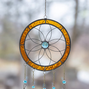Zoomed upper part of a stained glass dreamcatcher