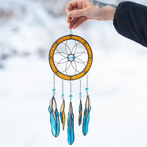 Stained glass dreamcatcher with blue feathers below