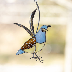 Female stained glass California quail suncatcher