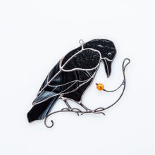 Load image into Gallery viewer, Sitting on the branch with berry stained glass raven window hanging