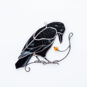 Sitting on the branch with berry stained glass raven window hanging