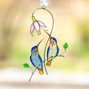 Pair of blue hummingbirds on the branch with pink flowers window hanging