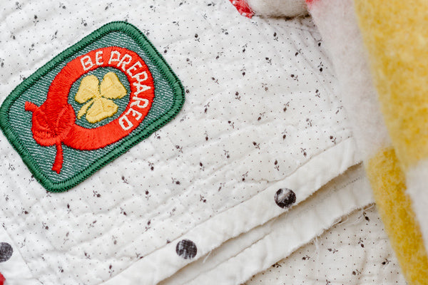 Close Up of a Canadian Girl Scout 'Be Prepared' Patch