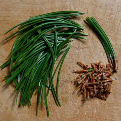 Pine needles on a cutting board for pine needle tea recipe