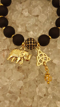 Load image into Gallery viewer, Black Matt beads with gold spacer beads, elephant and celtic charm  bracelet with matching earrings