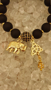 Black Matt beads with gold spacer beads, elephant and celtic charm  bracelet with matching earrings