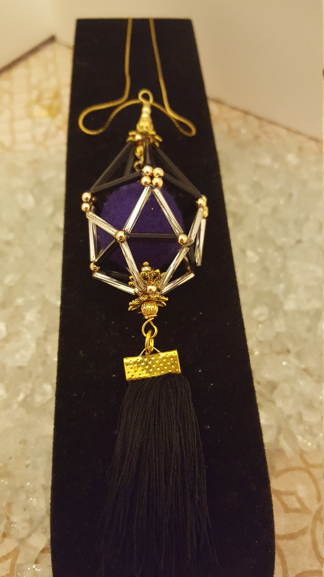 Black, gold, and silver / purple pom pom and black silk tassel essential oil diffuser necklace