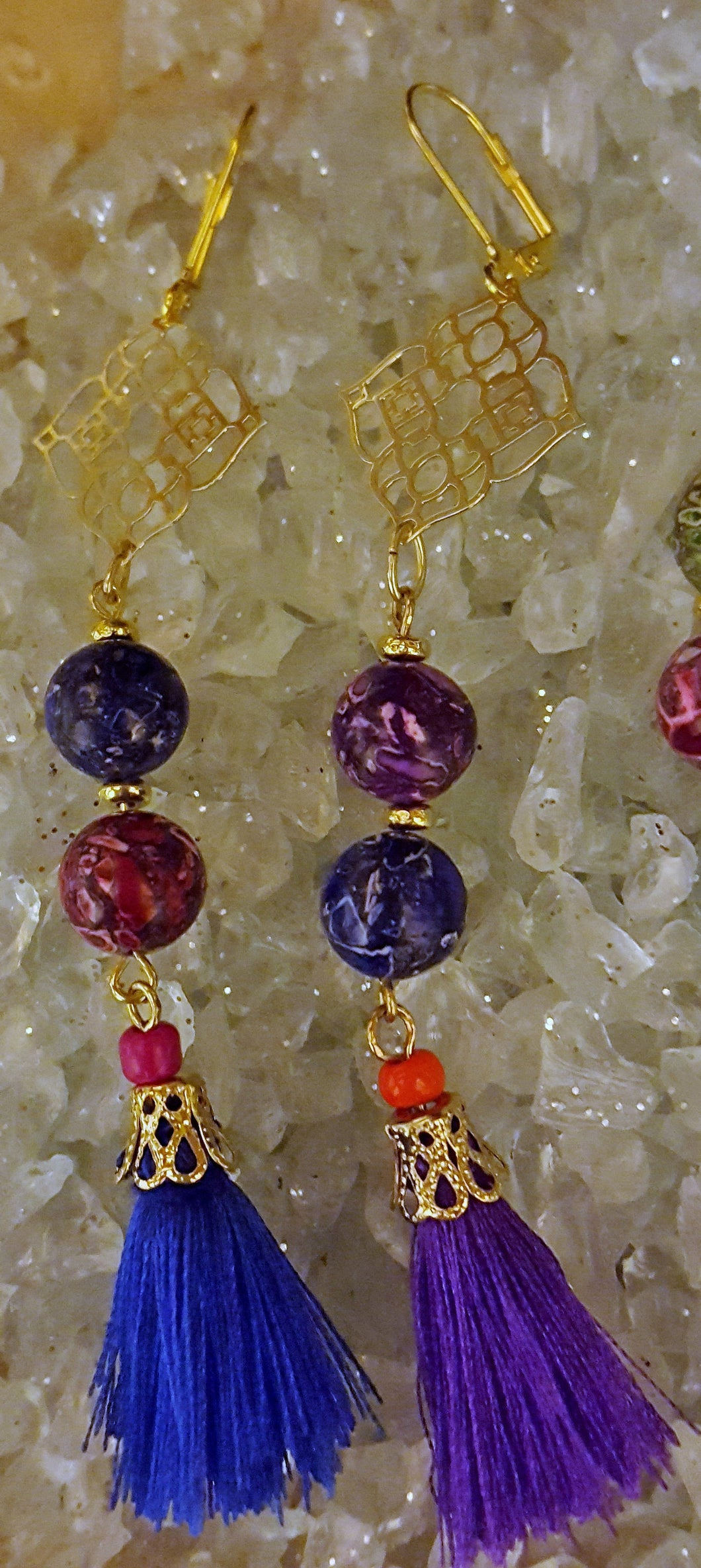 Elegant colored glass beads with gold findings and colorful tassels
