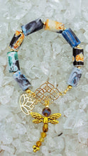 Load image into Gallery viewer, multi colored beaded bracelet with gold dragonfly and lotus flower charm