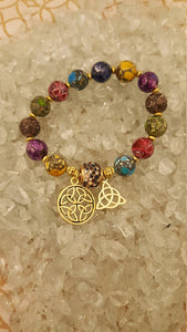 Multi colored elegant glass beads beaded bracelet with gold celtic charms and crystal focal bead