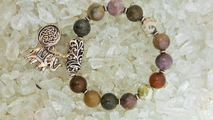 Elegant multi colored beaded bracelet with silver elephant and Celtic charm