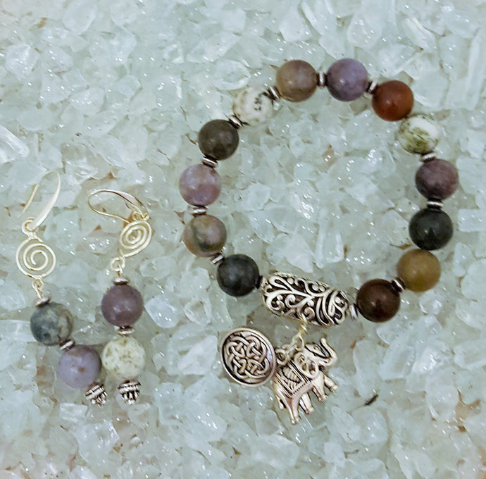 Silver beaded bracelet with matching earrings and elephant and celtic charm