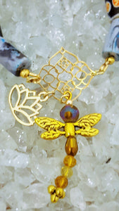 multi colored beaded bracelet with gold dragonfly and lotus flower charm