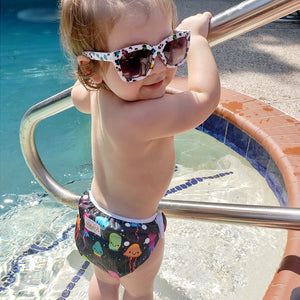 Reusable Adjustable Baby Swim Diapers - Camanda Baby - baby with sunglasses and swim diaper
