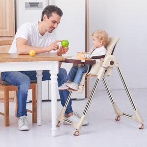 Baby Feeding Adjustable Folding High Chair with Wheels - Camanda Baby - dad with apple showing to baby in high chair