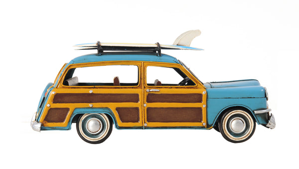 1949 Blue Ford Wagon Car with Two Surfboards