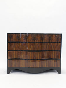 Contemporary serpentine-front chest of drawers.