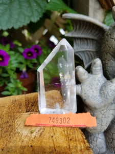 Lemurian Quartz point with calcite