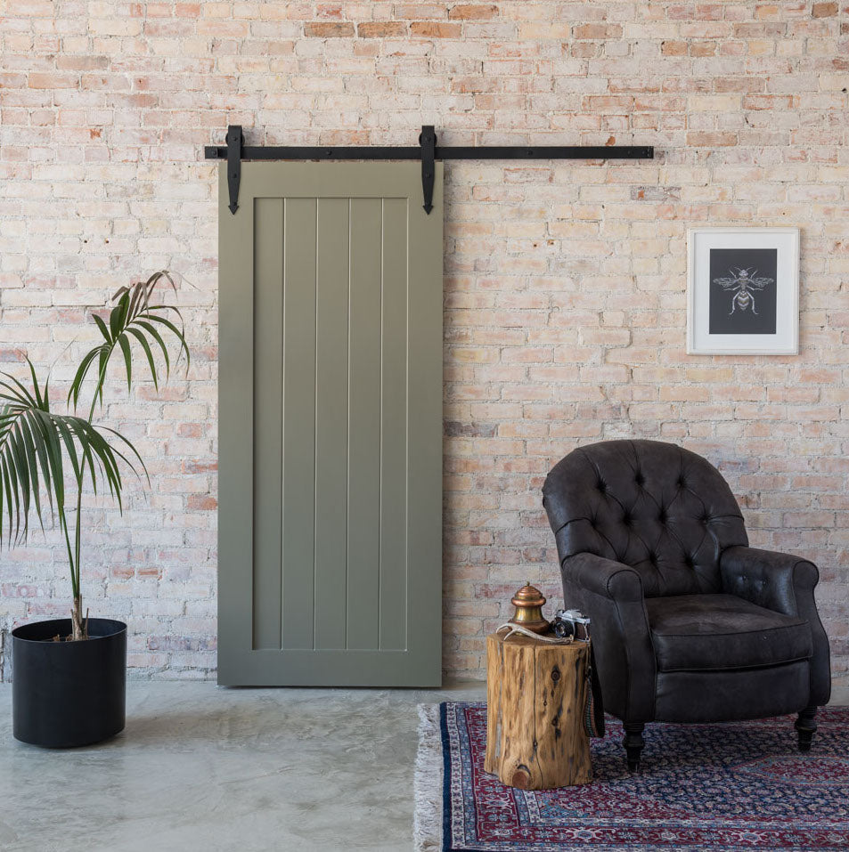 classic green barn door brick background